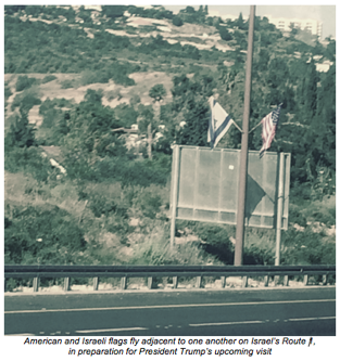 israeli and american flags on route 1